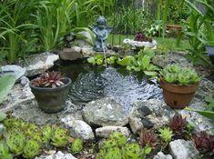 Garden pond with a cherub spitter