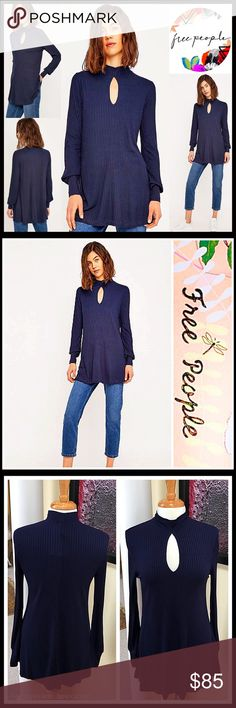 """FREE PEOPLE RIBBED SWING LONG SLEEVE TUNIC NEW WITH TAGS  SIZING- Subtly oversized, XS = will fit sizes 0-4  FREE PEOPLE RIBBED TUNIC  DETAILS- * Oversized body/relaxed loose knit A-line cape silhouette * Incredibly soft & flowy fabric * Mock neck, long sleeves, side slits, & front keyhole detail * Approx 31"""" long * Pullover/stretch-to-fit  FABRIC- 96% Rayon, 4% Spandex  COLOR- Navy  - FAST SHIPPING - OFFERS CONSIDERED - BUNDLE DISCOUNTS  SEARCH # T-Shirt copa banana turtleneck loose knit…"""