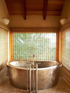 Silver pot tub. Love the window treatments and all the wood, too