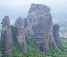 'Meteora'!  One of Christianity's holiest places, Meteora offers spiritual enlightenment and amazing photo-ops!   Go to see the incredible site of monasteries balanced on detached stone pinnacles 400m high! Rock climb (or ride up a cable car) and sit on top of a steep rock to contemplate life in the seclusion of this stone forest.