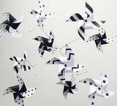 Adorable black and white pinwheel mobile by LilClementine.etsy.com The high-contrast patterns aid in developing the babies focus and depth perception. 10 mini pinwheels spin in the slightest breeze. The designs face the baby as they lay! Occupational Therapist love this for a sensory mobile! Ceiling hung mobile, first birthday gift, baby shower gift, downward facing mobile, baby girl nursery, baby boy nursery, gender neutral, playroom decor, pottery barn kids, arrows and Swiss cross