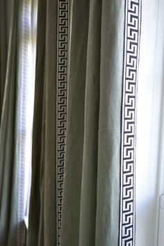 This weekend.... trim the living room curtains! either in coral or green