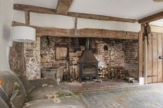 The heavily beamed 16th century drawing room is home to a huge inglenook, complete with bread oven, that extends two thirds of the length of the room