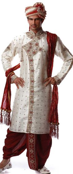 This Off White Brocade Traditional Dhoti Kurta for Men's is well adorned with hand embroidery and paired with maroon dhoti that completes the look. Actual product colors & designs may slightly vary.