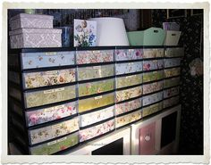 cover the plastic drawers by adding floral laminated paper . looks so much better, great idea.