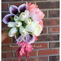 Wedding bouquet. Purple, Coral and white wedding flowers. True touch white tulips, peony, coral roses. Silk Coral snapdragons.