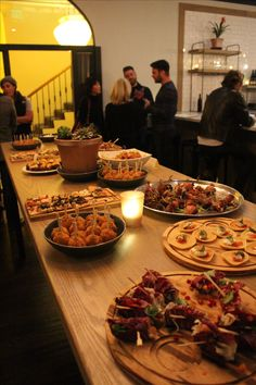 Appetizer highlights from the grand opening of Phlox Commons restaurant include dates wrapped in bacon and mini margherita flatbreads.