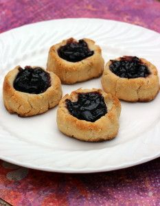 Gluten Free Coconut Thumbprints make a beautiful holiday cookie, and provide a lovely gluten free, vegan dessert option at holiday gatherings.