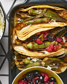 Please meatless diners with these unique tacos. Grilled okra replaces the beef or chicken, and garnishes including berry salsa and queso fresco make this vegetarian grill recipe temptingly colorful. #grilling #summerrecipes #summergrilling #grillingrecipes #bestgrilledrecipes #bhg
