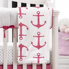This baby blanket is perfect for a modern nautical girl nursery. White with a hot pink anchors pattern. It is also versatile for playtime, tummy time, while rocking with baby, or in the stroller when