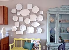Want to do a mini version of this in my dining room with some colorful plates.