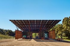 Texas architecture studio Clayton & Little has built a barn for Saxum Winery from reclaimed oil field pipes and weathering steel panels, topped with solar panels to provide power to a vineyard in California. Little Architects, Steel Barns, Agricultural Buildings, Weathering Steel, Solar Projects, Steel Panels, Roofing Systems, Decoration, Solar Panels