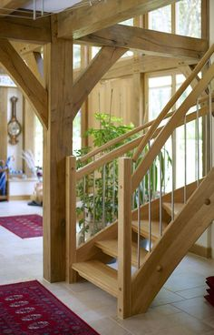 Detail of how an oak post can be used as a point to spring the spiral oak staircase. The post & beam is being used to define space. Open Staircase, Staircase Railings, Stairs, Staircases, Cottage Style, Farmhouse Style, Oak Framed Buildings, Oak Frame House, Energy Efficient Homes