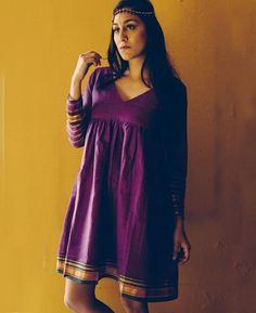 Boho style purple and gold V neck flared dress by Mogra made from an Indian Poona Saree. Saree Gown, Sari Dress, Frock Fashion, Fashion Dresses, Pink Fashion, Fashion Wear, Indian Designer Outfits, Designer Dresses, Kalamkari Dresses