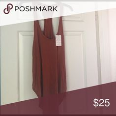 Free People Tank new with tags! in perfect condition! Color is autumn orange (so like a dark orange) Free People Tops