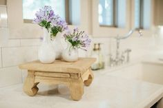 I really like this wooden stand.   Fixer Upper. The Reeds- white vase