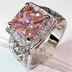 Pink Kunzite surrounded by micro-pave White Topaz