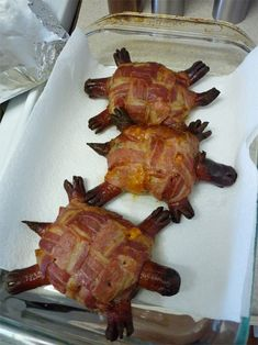 Bacon Cheese Turtleburgers - ground beef patties topped with sharp cheddar cheese and wrapped in woven bacon, impaled with hot dogs for the heads, legs, and tails.