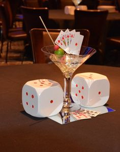 """Centerpiece with 10"""" martini glass vase with poker cards and two large dice"""