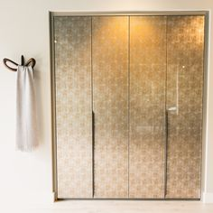 Our Decorative Glass doors. Neatsmith designs and installs bespoke wardrobes, dressing rooms and bedroom furniture to create your perfect bedroom. Our wardrobes are made to measure and are completely tailored to your needs. #walkinwardrobes #wardrobes #dressingrooms #home #bedroom #bedroomideas #bedroominteriors #madetomeasure #golddecor #gold #sparkle