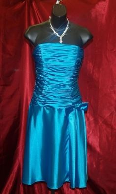 Blue Neblome Short Dress Size: 6 Turquoise Dress. This site has used bridemaids dress. There is so much stuff out there eeepppp