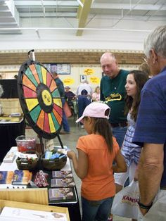 Prize WheelAt one stop, they could spin a Wheel-of-Fortune-like wheel. If they answered a wheat question correctly, they got a prize. Actually, I think they got a prize either way. Buy this Prize Wheel at http://PrizeWheel.com/products/tabletop-prize-wheels/tabletop-black-clicker-prize-wheel-18-slot/.