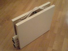 turn your ikea tables into folding tables. these are the ones in my craft room! would work nice for craft fairs, too