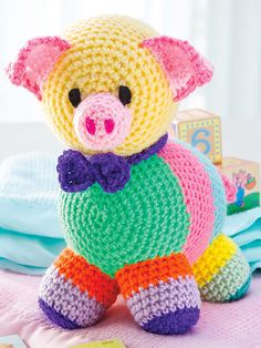 This darling pig will fill your little one's heart with joy and put a smile on their face! Includes written instructions only. This e-pattern was originally published in the April 2016 issue of Crochet World magazine.