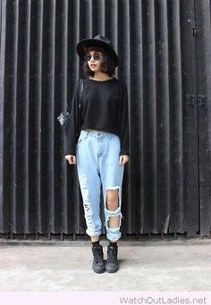 Light blue jeans with a black blouse and accessories