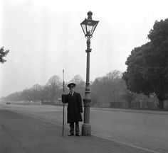 """""""Dublin History ~ Gas Lamplighter in the Phoenix Park in the the gas lights still exist but they are now automatic"""" Gas Lights, Dublin City, Dublin Street, Photo Engraving, Local History, After Dark, Gothic Fashion, Old Photos, How To Find Out"""