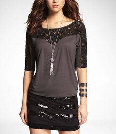LACE YOKE EAST-WEST TEE at Express  (Idk why...but I am in love with this. Prolly going to get it today actually)