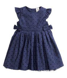 DESCRIPTION  Dress in woven cotton fabric with eyelet embroidery, short butterfly sleeves, and decorative bows at waist. Buttons at back. Liner skirt with a ruffled tulle hem. Lined.