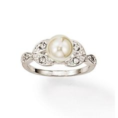 Available in size 8 only.A beautiful classic style ring, featuring faux pearls with rhinestones set in silvertone.