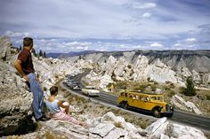 Photo: Tourists exploring the travertine hoodoos of Yellowstone National Park