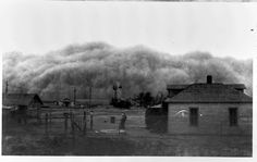 This undated photograph captures a large dust storm about to hit this family's homestead. These storms were frequent occurrences in western Kansas during the 1930s Dust Bowl.    Date: Around 1935