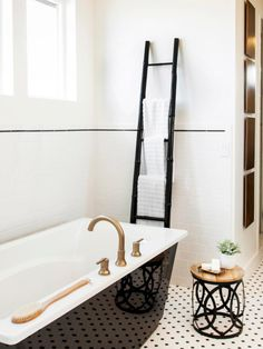 Black and White Bathroom With Chic Soaking Tub | HGTV >> http://www.hgtv.com/design-blog/design/best-fall-design-trends-from-interior-designers?soc=pinterest