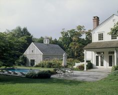 Country house with french doors and porch overlooking pool...love the barn/garage too!