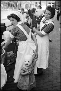 Leonard Freed - Amsterdam. 1964. Hospital nurses with children.