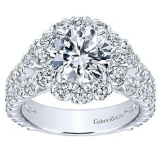 This ring features of round diamonds with a substantial split shank of pave set round diamonds. Features a large round floral h Round Halo Engagement Rings, Engagement Ring Styles, Do It Yourself Fashion, Black Gold Jewelry, White Gold Diamonds, Round Diamonds, Or Rose, Rose Gold, Diamond Jewelry