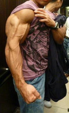Huge arm: delts, biceps, triceps, and veins.