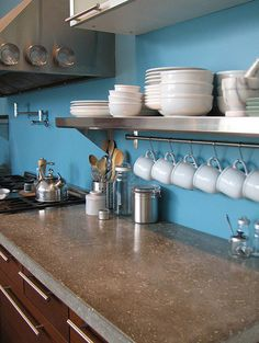 concrete countertop; love the stainless steel shelf with the cup holders too!