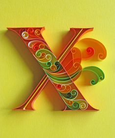 Paper typography of the English alphabet using strips of colored paper.