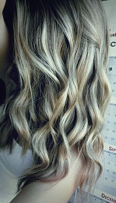 Sucessful beach waves. Lightly curl with a wand then run a flat iron over the curls softly.