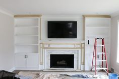 The before and after of a living room makeover with white built-ins flanking a fireplace. Love the addition of built-in bookcases for storage and a place to showcase pretty decor. fireplace decor White Built-Ins Around the Fireplace: Before and After Bookshelves Around Fireplace, Built In Around Fireplace, Fireplace Built Ins, White Fireplace, Fireplace Remodel, Diy Fireplace, Living Room With Fireplace, Fireplace Design, My Living Room