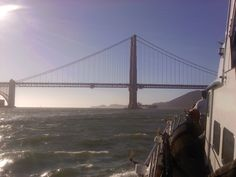 San Francisco and a boat cruise heading towards the Golden Gate Bridge.
