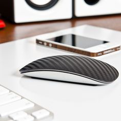 Carbon fiber adds a textured weave to the surface of your Magic Mouse. This greatly enhances usability by allowing your fingers to swipe with ease, and a new, heightened level of precision - greatly enhancing every click, scroll and swipe. Color: black.