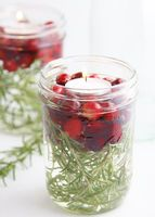 Fill jars or vases with natural fillers for your Thanksgiving table like cranberries, small gourds, or even herbs submersed in water with floating candles on top.