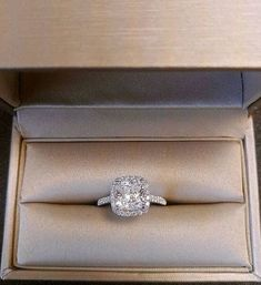 She will love this beautiful and traditional cushion cut halo set engagement ring, with a 3 carat cushion cut center man made diamond and round side diamonds. The side diamonds are set in a single row Wedding Ring Cushion, Engagement Rings Cushion, Dream Engagement Rings, Cushion Ring, Vintage Engagement Rings, Solitaire Engagement, Solitaire Rings, Box Cushion, Diamond Engagement Rings
