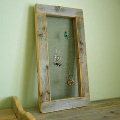 Make a rustic earring organizer using salvaged wood and wire netting.