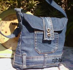 Small cross body bag made from repurposed jeans.